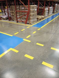 Univar Food Products warehouse doing concrete polishing of floors and new blue and yellow safety walkways.