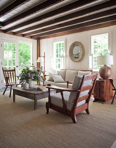 """""""To give your rooms a cohesive, polished look, tell a color story with accessories. Start with the living room and strip out all the bits and pieces. Then choose one color and thread it back into the room with vases, candlesticks, pillows, and throws. Place a lacquered tray in the same color on the coffee table."""" -Shawn Henderson For the living room of a New York farmhouse the designer chose a refined palette.   - HouseBeautiful.com"""