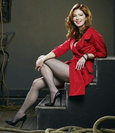 Dana Delany legs in a red trench coat, stockings and high heels