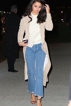 Selena Gomez in flare denim with a nude trench.