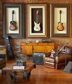 What's new At Frame By Frame: Guitars on the wall?