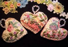 Heart ornaments made out of an old quilt and embellished.  So lovely!