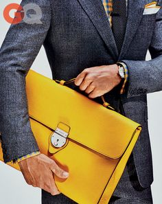 Briefcase, $2,450, by Gucci Suit, $2,890, by Gucci Watch by Hamilton