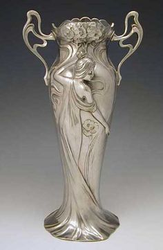 Polished pewter vase with art nouveau figural maiden decoration and original glass liner WMF, designer, Germany (marked on base)   ...    c.1906