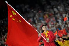 China's flag-bearer Yao Ming carries the national flag as he leads his country's Olympic team during the opening ceremony of the Beijing 2008 Olympic Games.