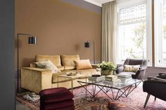 """The Dulux Colour of the Year 2018 has been revealed as Heart Wood - a dusky mauve that will bring a sense of comfort to the home. The calming hue, described by Dulux as a """"warm neutral with a hint of heather"""", was announced alongside other colour palette predictions as part of the leading paint brand's annual trend forecast. This theme of the home as a sanctuary is reflected in the Colour of the Year, which is inspired by the """"beautifully warm wooden materials being used in..."""