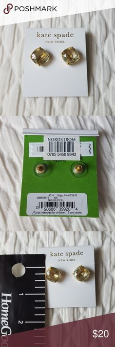 kate spade green earrings with 14K gold fill Brand new, never worn or tried on they are just a bit big for my smaller ears. Nice green peridot like shade with gold colored hardware. Small square stud earrings. kate spade Jewelry Earrings