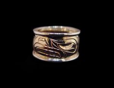 """Gold Eagle Ring, Sheldon Williams, Heiltsuk .  Gold with silver rails, 0.5"""". Northwest Coast First Nations Jewelry."""