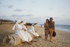 Could have been yesterday: a young hippie couple from France and Australia stroll on the beach in front of a group of nuns in Goa, India, 1971. (Jack Garofalo/Paris Match)
