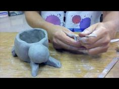 great video for animal pinch pots; emphasizes score, slip, blend, smooth. (5:11) GOOD INTRO TO CLAY