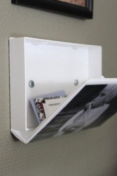 use old plastic VHS case to display a picture and also have semi-hidden storage.... Thinking of ways to utilize this idea...