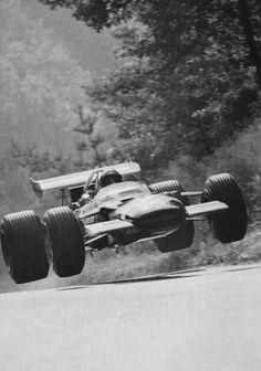 """oldschool-brain:    JUMP!  flying jo!  Jo Siffert in volo con la sua Lotus Ford 49B del Rob Walker Racing Team nel tratto """"Kesselchen"""" del Norschleife, durante il Gran Premio di Germania 1969."""
