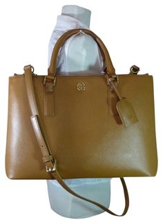 Tory Burch Saffiano Leather Large Robinson Double-zip Brown Tote Bag. Get one of the hottest styles of the season! The Tory Burch Saffiano Leather Large Robinson Double-zip Brown Tote Bag is a top 10 member favorite on Tradesy. Save on yours before they're sold out!