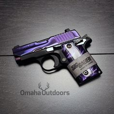 """I NEED this beautiful gun! """"Some guns are sought after, some guns are lusted over, and some guns are – exclusive. No word can better describe the Sig Sauer PSP Purple w/ Pearl Grips. This impeccable pistol is a distributor exclusive, by Omaha Outdoors. Weapons Guns, Guns And Ammo, Purple Gun, Katana, Sig Sauer P238, 380 Acp, Night Sights, Custom Guns, Firearms"""
