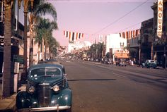 1940s Street | street scene, c. 1944. A banner hanging over the street reads ...