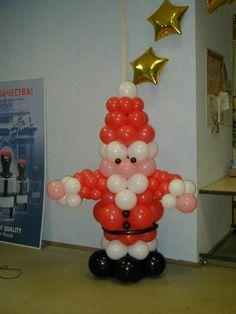 Decora tu fiesta navideña usando columnas de globos
