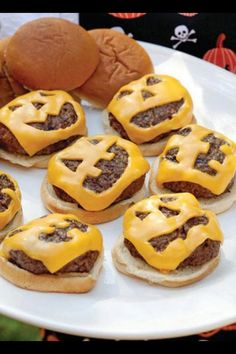 Awesome Halloween food! Using cookie cutters or a knife cut out a jack o lantern face on a cheese slice, melt on burger and serve!