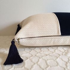 Custom white and navy velvet lumbar pillow with navy tassels!   #pillowlove #madeinbrooklyn #hartleyjonesdesign #handmade #velvet #tassels #ririzippers #design #customorder #etsy #glamdecor