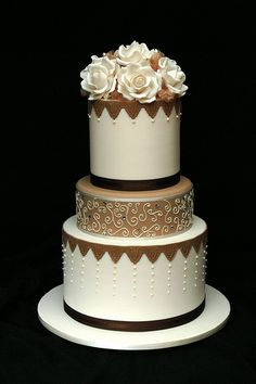 Elegant bronze and ivory contemporary modern wedding cake with ivory roses. I love this cake. The colours and the detail are all so lovely. Beautiful Wedding Cakes, Gorgeous Cakes, Pretty Cakes, Amazing Cakes, Unique Cakes, Elegant Cakes, Brown Wedding Cakes, Purple Wedding, Gold Wedding