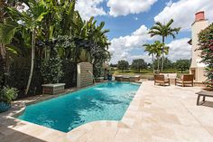 Imagine lounging by this saltwater pool with a cocktail. You can! This beautiful Mediterra Naples home is for sale.