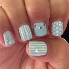 Polka dots, stripes, glitter and stones atop a simple baby blue base are feminine and fun. #nails #nailsoftheday