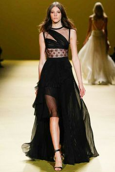 Black pleated chiffon gown embellished with crystal-embroidered tulle insert by @J. Mendel. #IStyleNY #Style