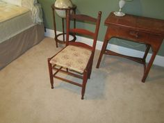 """Middle bedroom furniture including full size mattress/box spring on metal frame; 1950's maple sewing machine cabinet 29""""Tx29""""Wx20""""D with Kenmore sewing machine (functionality unknown); small ladder back chair; modern globe with mahogany stand; pine bookcase 74""""Tx37.5""""Wx11.5""""D"""
