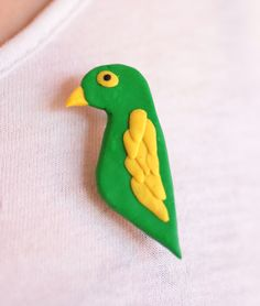 Polly parrot brooch handmade from fimo. £2.00.
