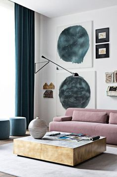 modern living room with dark blue velvet curtains and dusty rose velvet sofa | modern wall gallery and light fixture | brass coffee table | Get the look with Bemz customisable curtains in dark blue velvet