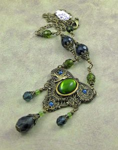 Vintage Olive Green Czech Glass Cabochonand Antiqued by beadlady5, $60.00
