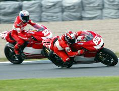 Loris Capirossi dives inside team-mate Troy Bayliss.
