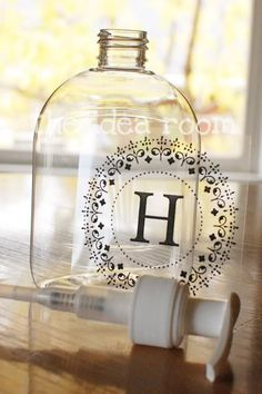 DIY MONOGRAMMED SOAP DISPENSERS: Use goo gone to remove existing label on dollar store hand sanitizer, then print your monogram onto a sheet of clear contact paper cut to fit into printer- fit up to 8 different monograms on one page. Give it a few minutes to let it dry, then cut with scissors into oval shape to fit bottle. Give as gifts!