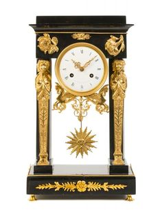 An Empire Gilt Bronze Mounted Marble Mantel Clock Height 16 7/8 inches.
