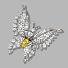 DIAMOND BUTTERFLY BROOCH, BULGARI The marquise-shaped diamond of fancy deep orangy yellow color weighing 2.56 carats, additionally set with round, marquise-shaped, baguette and pear-shaped diamonds weighing approximately 21.90 carats, mounted in platinum, signed Bulgari.