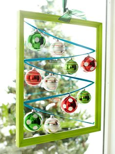 Create a Hanging Window Display with an empty frame, ribbon, and spare ornaments.