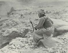 A Mahsud tribesmen, 1919 (c). Photograph by Randolph Bezzant Holmes (1888-1973), North West Frontier, Waziristan (1919-1920).  The Mahsuds were Pathan tribesmen who inhabited Waziristan. They were probably the most formidable fighters on the frontier. Highly mobile, able to live off the most meagre rations, and fine shots, they were perfectly adapted to their mountainous homeland.