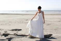Christy poses on the beach in her washed Cambodian silk organza gown....http://www.pinterest.com/cocoonsilknw/custom-bridal-gowns/