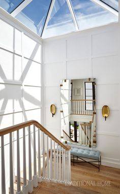 A skylight allows sunlight to flood the stair landing. - Photo: Carmel Brantley / Design: Lisa Peterson and Melanie Hayes