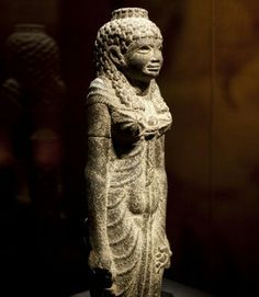 Standing statue of the Egyptian goddess Isis, or a queen, carved from black granite during the Roman Period (27 B.C. - A.D. 275).