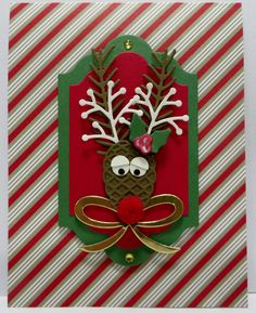 Stampin' Up Reindeer card created by Lynn Gauthier using SU's Candy Cane Lane DSP, Oh What Fun Stamp Set, Pretty Pines & Christmas Stockings Thinlits, Lots of Labels & Layering Ovals Framelits Dies and Owl Builder Punch. Go to http://lynnslocker.blogspot.com/2016/11/stampin-up-candy-cane-lane-oh-what-fun.html to see how I designed this Reindeer.