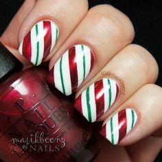 "Nails / Nailart - Yummy candy cane stripes for Christmas. All OPI polishes: ""Alpine Snow"", ""Jade is the New Black"" and ""In My Santa Suit"". --- Instagram @majikbeenz"