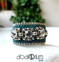 Ring made of peyote embellished with rhinestones.