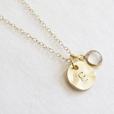 Initial Charm With Swarovski Charm Necklace. Beautiful 14k gold plated hammered Initial coin and swarovski charm necklace with initial of your choice.