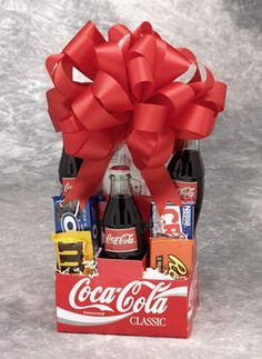 Perfect for the soda and candy lover in your family, this Coca-Cola gift basket comes in an old-fashioned six-pack box and features three bottles and assorted candy. You'll be a big hit with anyone who receives one of these delicious baskets.