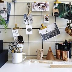 Hang a piece of gridded wire above your desk to keep pictures and inspiration visible.