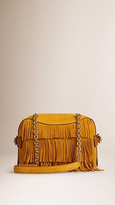 Burberry Copper The Small Alchester in Suede Fringe - A mini bowling bag in tiered suede fringing with polished metal chain and leather shoulder straps. The bag features a double-layered construction with concealed wing pockets. Discover the women's bags collection at Burberry.com