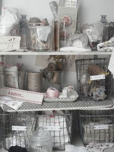 Love the vintage wire baskets in this sewing cupboard