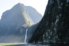 Scenery of Milford Sound at Stirling Falls, queenstown to milford sound tour, south island road trip New Zealand Travel Guide, New Zealand South Island, Milford Sound, Stirling, Things To Do, Waterfall, Road Trip, Scenery, Places To Visit