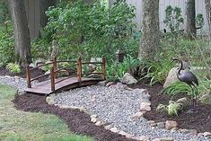 What a terrific idea. This crafty lady made a dry creek bed in her yard, from rocks, gravel and a footbridge she purchased. - Gardening For You