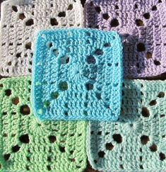 """These crochet squares have a lacy """"X"""" design that makes it perfect for a Valentine's Day X's and O's afghan."""